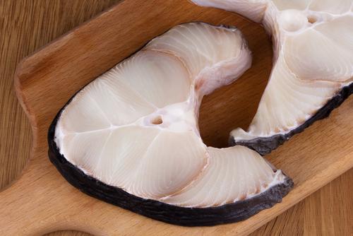 shark meat steaks on cutting board